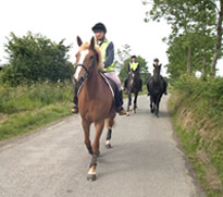 Riders wearing high visibility jackets on country roads near Aspatria, Cumbria
